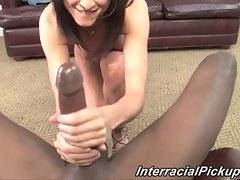 Sexy white babe sucks big black cock before sitting down on it.