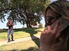 Black guy spots lovely blond milf in park and offers her to do photo shoot.