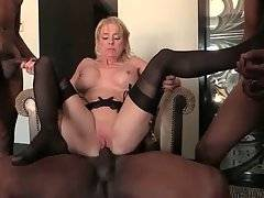Pretty white lady greatly enjoys hot interracial foursome.