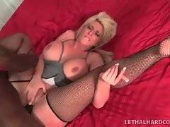 Nasty mature blonde holds her legs widely open for deeper penetration.