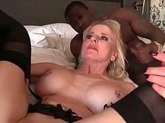 Three Black Studs Share Older White Lady 3