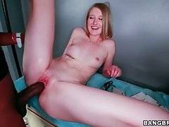 Summer Carter widely spreads her legs for deeper penetration.